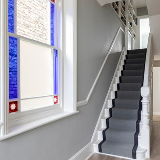 Photo of a medium sized traditional staircase in London.