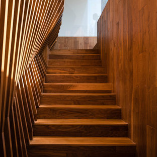 This is an example of a modern wood staircase in Los Angeles with wood risers.