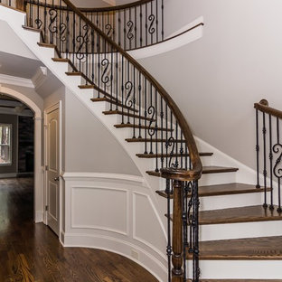 Huge elegant painted curved staircase photo in Raleigh