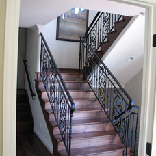 Mediterranean Staircase by LuAnn Development, Inc.
