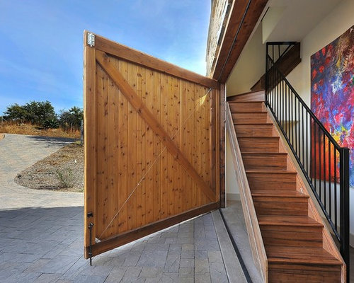 Got pounded! Barn door style swinging garage door Interest