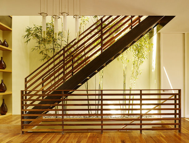 Contemporary Staircase by Design Line Construction, Inc.