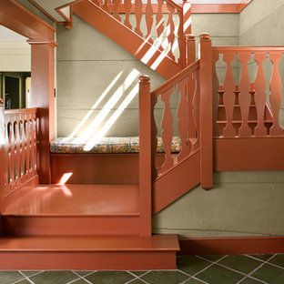 Mountain style painted u-shaped wood railing staircase photo in Boston with painted risers