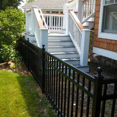 Contemporary Staircase by Straight Line Fence