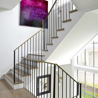 Country wooden l-shaped metal railing staircase photo in Chicago