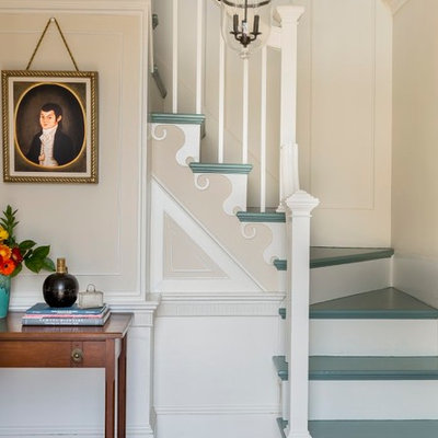 Example of a classic painted l-shaped staircase design in Boston with painted risers