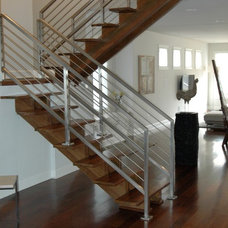Modern Staircase by Lankford Decorating & Construction, Inc.