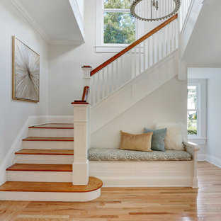 Staircase - large transitional wooden l-shaped wood railing staircase idea in Tampa with wooden risers