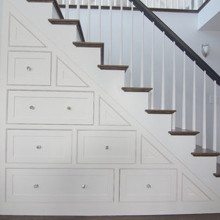 Example of a large transitional wooden straight wood railing staircase design in Boston with painted risers