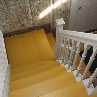 """Idee per una scala a """"L"""" classica di medie dimensioni con pedata in legno, alzata in legno e parapetto in legno"""