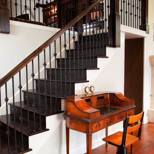 Ornate wooden straight staircase photo in Chicago with wooden risers
