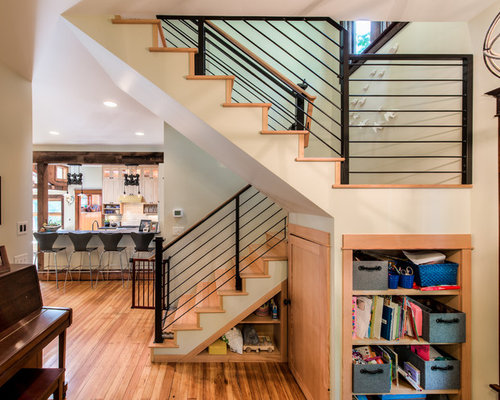 Example Of A Transitional Wooden U Shaped Staircase Design In Denver