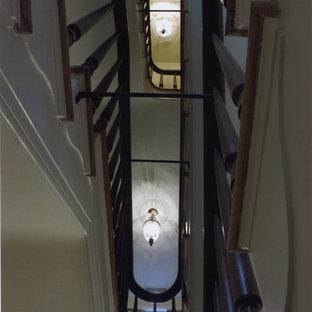 Foto de escalera curva, de estilo de casa de campo, con escalones de madera y contrahuellas de madera