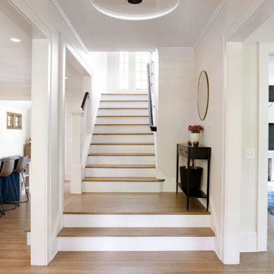 Inspiration for a large transitional wooden u-shaped wood railing staircase remodel in Minneapolis with painted risers