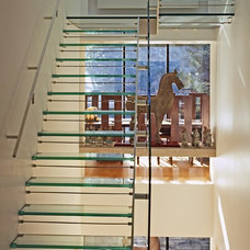 Contemporary Staircase by wisdom inc.