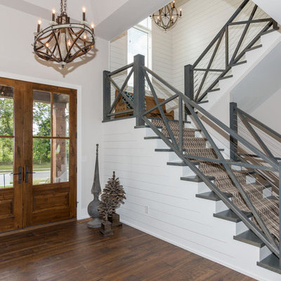 Inspiration for a mid-sized farmhouse wooden u-shaped mixed material railing staircase remodel in Indianapolis with painted risers