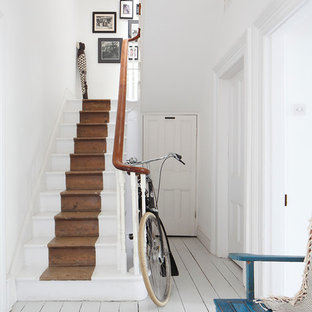 Example of a classic painted straight staircase design in London with painted risers