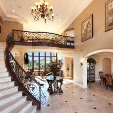 Mediterranean Staircase by Cornell Custom Homes, Inc