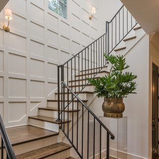 Inspiration for a transitional wooden l-shaped metal railing staircase remodel in Nashville with painted risers