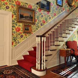 Elegant wooden straight staircase photo in Other with painted risers