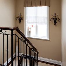 Traditional Staircase by Merigo Design