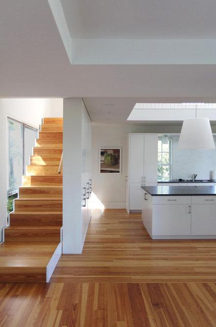 Transitional Staircase by Elliott + Elliott Architecture