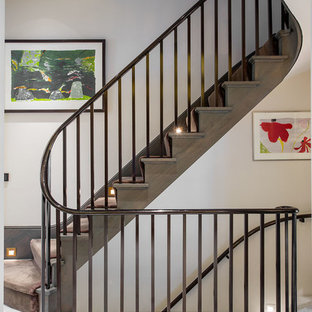 Inspiration for a contemporary wood staircase in London with wood risers.