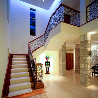 Example of a trendy wooden staircase design in Milwaukee