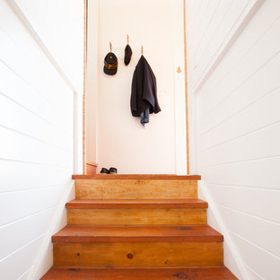 This is an example of a small scandinavian wood straight staircase in San Francisco with wood risers.