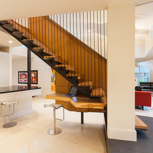 Example Of A Large Trendy Wooden Straight Open Staircase Design In Houston