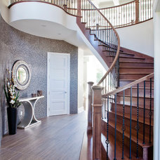 Transitional Staircase by Rebecca Mitchell Interiors & Boutique