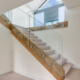 Design ideas for a contemporary carpeted straight staircase in Devon with carpeted risers.
