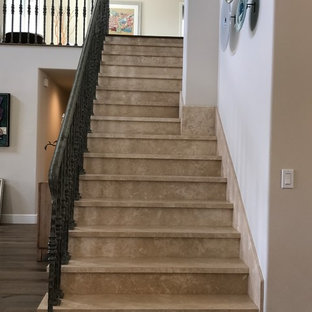 Mid-sized transitional travertine straight metal railing staircase photo in Orange County with travertine risers