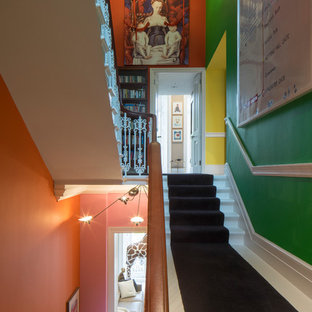 Inspiration for a medium sized eclectic carpeted u-shaped staircase in London with carpeted risers.
