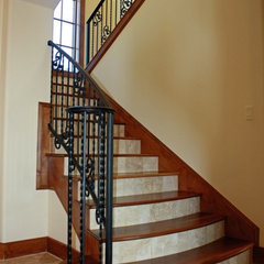 mediterranean staircase by SILVERTON CUSTOM HOMES