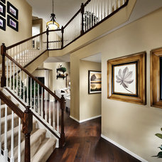 Traditional Staircase by Village Homes