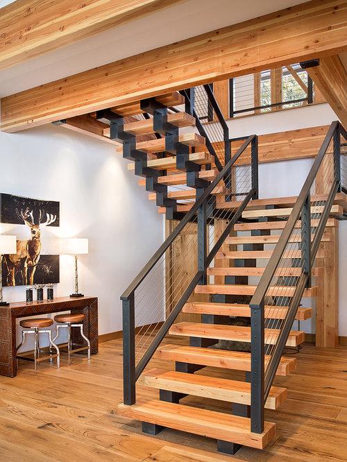 ejemplo de escalera suspendida rstica sin con escalones de madera y barandilla