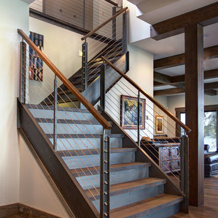 Large urban wooden l-shaped staircase photo in Detroit with metal risers