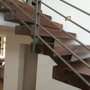 Inspiration for a mid-sized industrial wooden floating staircase remodel in Austin with wooden risers