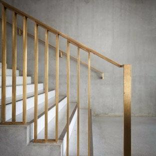 Источник вдохновения для домашнего уюта: лестница в стиле модернизм с бетонными ступенями и бетонными подступенками