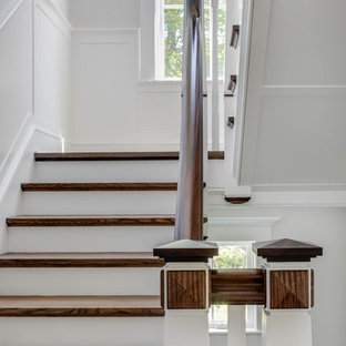 Example of a large classic wooden u-shaped wood railing staircase design in Boston with painted risers