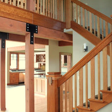 Traditional Staircase by Concept Builders, Inc.