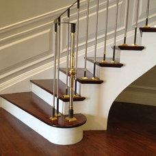 Contemporary Staircase by HMH Iron Design