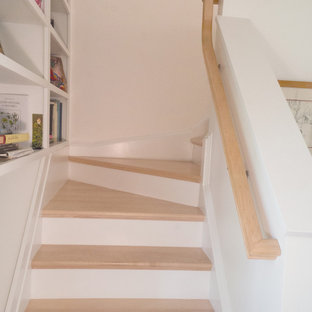 Inspiration for a small modern painted l-shaped staircase remodel in Providence with wooden risers