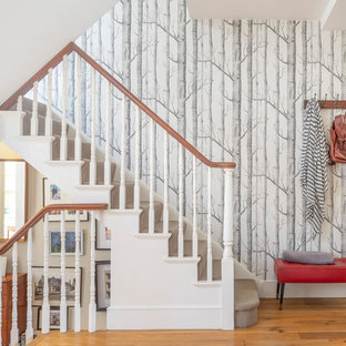 This is an example of a traditional carpeted u-shaped wood railing staircase in Sussex with carpeted risers.