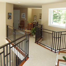 Eclectic Staircase by Cascade Homes Custom Construction LLC