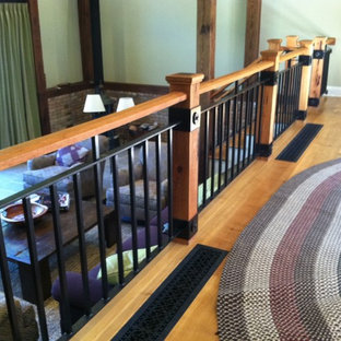Design ideas for a rustic wood staircase in Boston with wood risers.