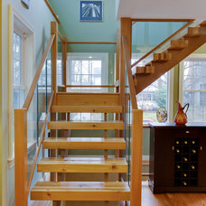Traditional Staircase by Gmanu & Associates