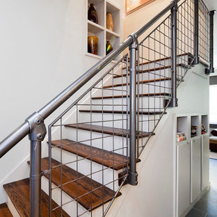 Mid-sized urban wooden u-shaped staircase photo in Austin with painted risers