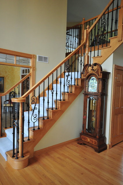 Traditional Staircase by Jusalda custom stairs Inc,
